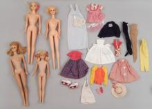 Three Barbies and one Skipper doll with clothes