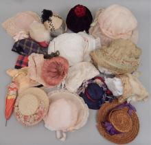 Grouping of antique and vintage doll hats
