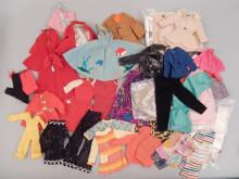Grouping of Barbie doll clothing and patterns