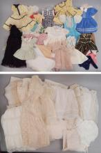 Large collection of doll clothes