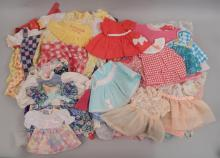 Grouping of doll dresses
