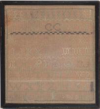 Framed needlework sampler