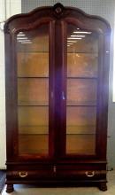 Oak double glass door bookcase, one long drawer below