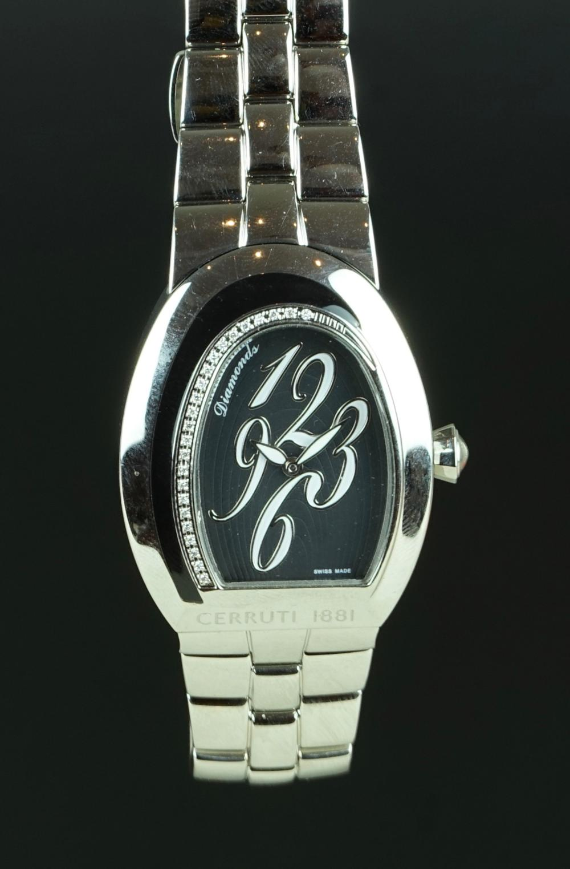c0df8c7017 LADIES CERRUTI DIAMOND SET WRISTWATCH, black dial with arabic numerals in a