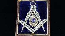 Masonic pendant/badge, set with paste stones and a central 'G' set in a blu