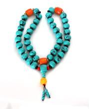STRAND OF TURQUOISE  COLOURED BEADS WITH ORANGE ACCENTS
