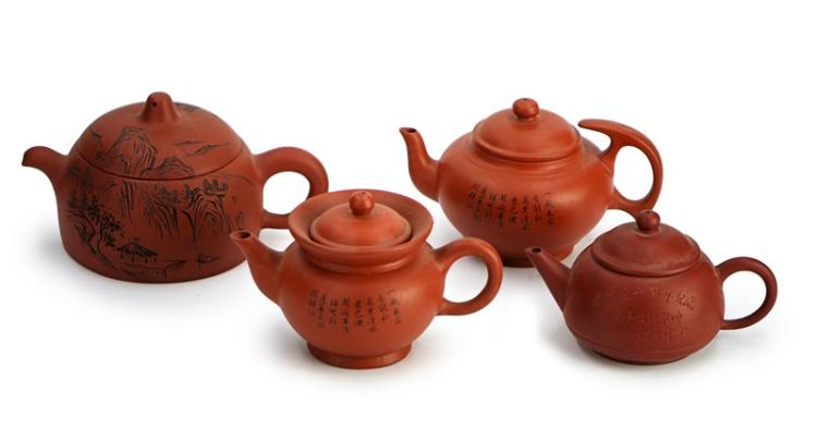 SET OF FOUR YIXING CLAY TEAPOTS