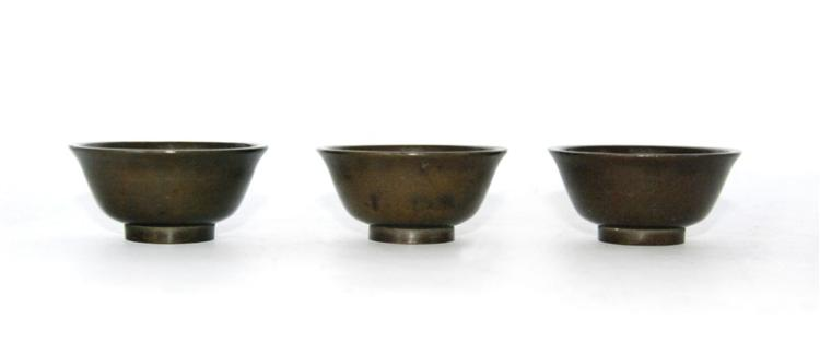 SET OF BRONZE CUPS