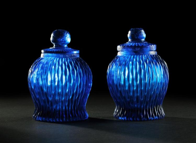 PAIR OF BLUE CARVED GLASS CANISTERS