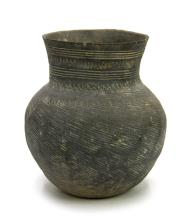 AN EARLY EARTHENWARE JAR