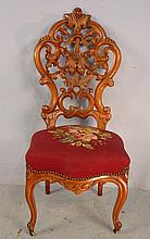Walnut Victorian needlepoint chair, pierced carved back with maroon colored seat, 41in. T, 18in. W, 17in. D, ca. 1870.