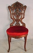 Rococo rosewood pierced carved music chair, red upholstery seat, heavy carving in crown, ca. 1855, 37in. T, 16in. W, 17in. D.