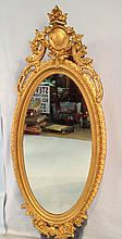 Oval Victorian gold mirror, 61in. T x 27in. W.