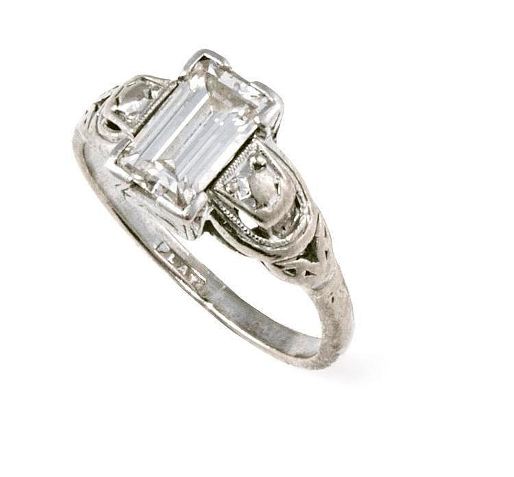 Diamond ring claw-set with a baguette diamond