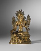 Gottheit Weisse Tara, Tibet, 19. Jh. Bronze. In Meditationssitzhaltung, auf Lotossockel. Der rechte Arm ist im Mudra ausgestreckt, der linke angewinkelte in der Argumentationsgeste. Seitlich je eine...