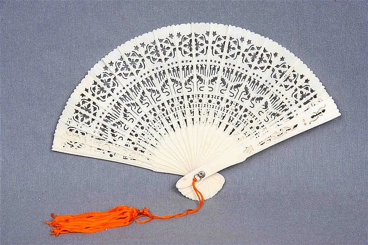 A CHINESE IVORY HAND FAN, CIRCA 1940