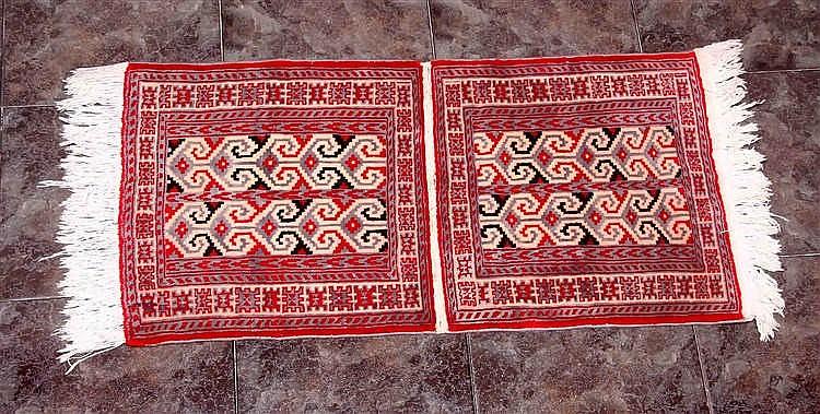A PERSIAN WOOL CARPET
