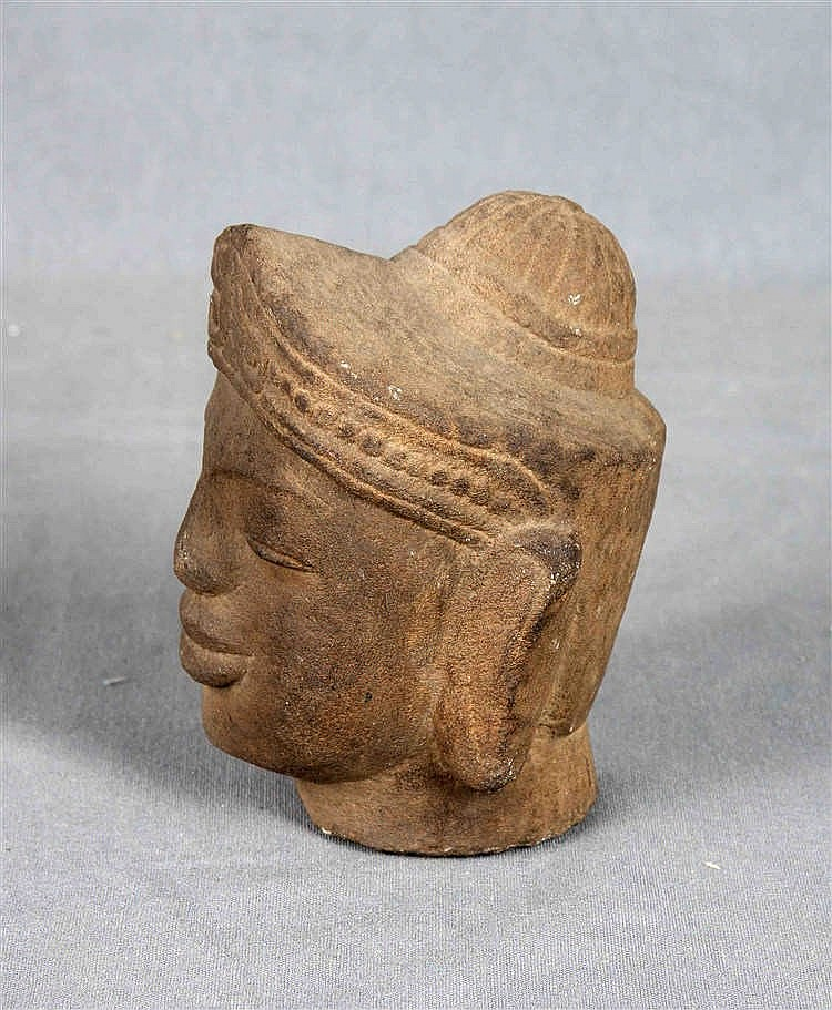 An antique carved stone head