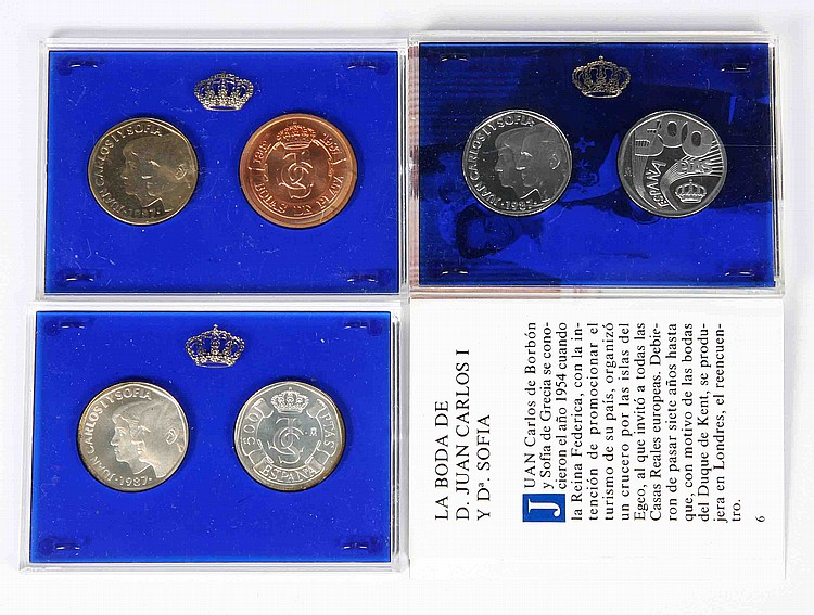 A CASE WITH SIX COMMEMORATIVE COINS OF THE XXV ANNIVERSARY OF THE WEDDING OF THEIR MAJESTIES THE KINGS OF SPAIN, JUAN CARLOS AND SOFÍA.