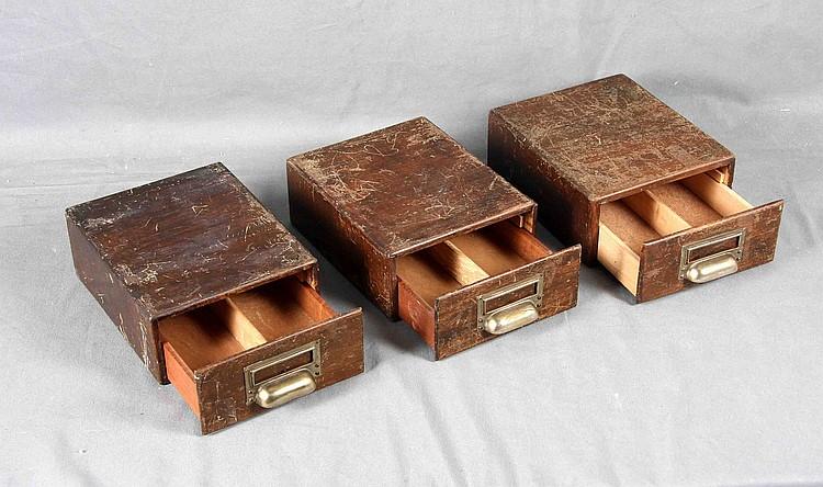 A SET OF THREE FILING DRAWERS