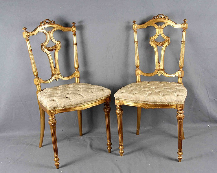 A PAIR OF LUIS XVI STYLE CARVED GILT WOOD CHAIRS