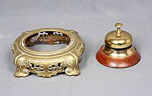 A BRONZE WOOD HOTEL BELL AND GILT BRONZE VASE STAND