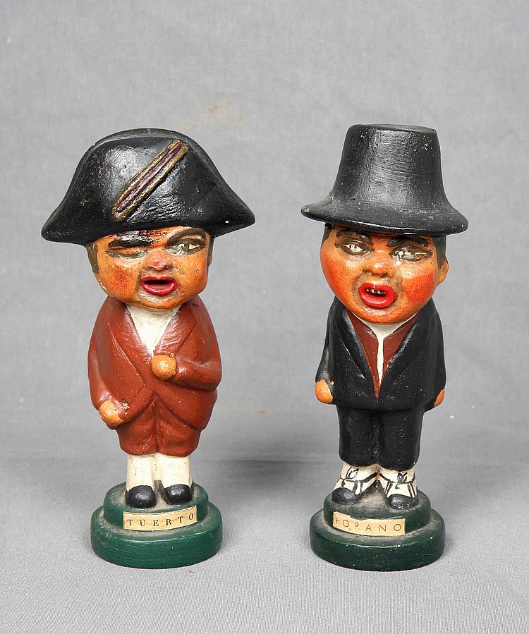 A PAIR OF SPANISH POLYCHROME CERAMIC FIGURES