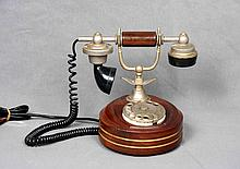 AN ANTIQUE WOOD AND METAL TELEPHONE