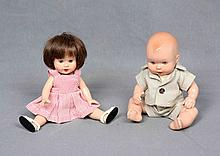A PAIR OF DOLLS, CIRCA 1950