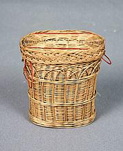 A TRAVEL DRINKING GLASS IN FITTED BASKET