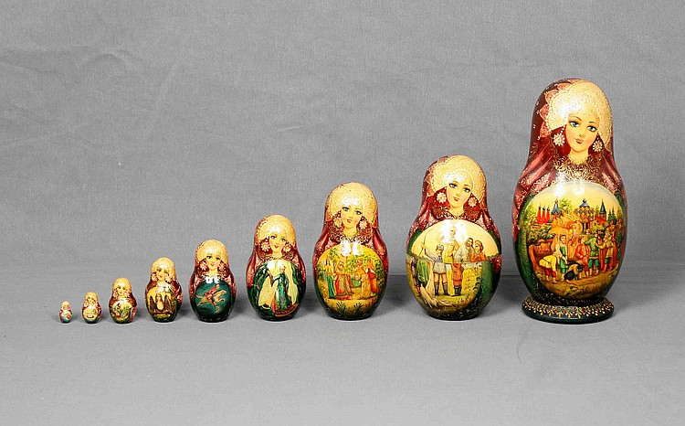 A SET OF NINE POLYCHROME WOOD RUSSIAN MATRYOSHKA DOLLS