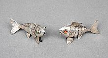 A PAIR OF SILVER FISH FIGURES
