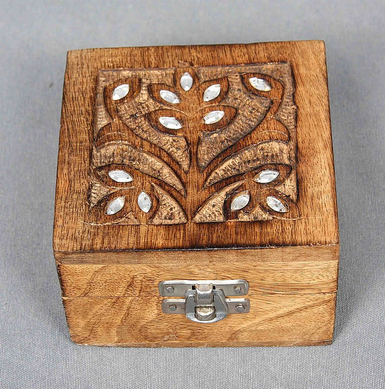 A SMALL CARVED WOOD BOX