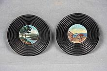 ILLEGIBLE. A PAIR OF PAINTED WOOD DISHES