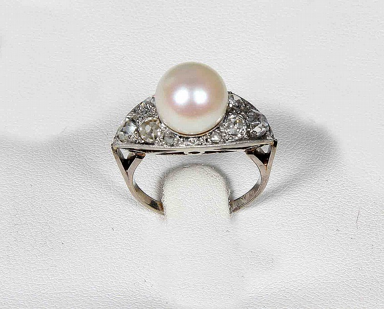 A PEARL, DIAMOND AND PLATINUM RING
