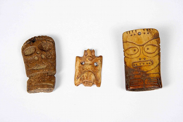 A SET OF THREE TAINO CARVED BONE PENDANTS