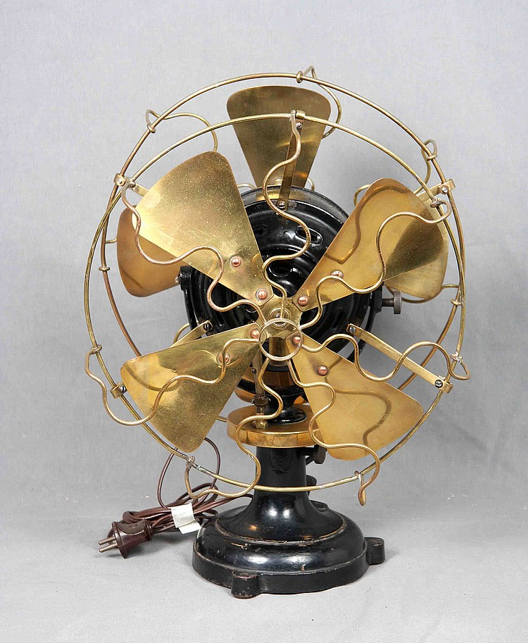 AN ANTIQUE MARELLI IRON AND BRONZE VENTILATOR