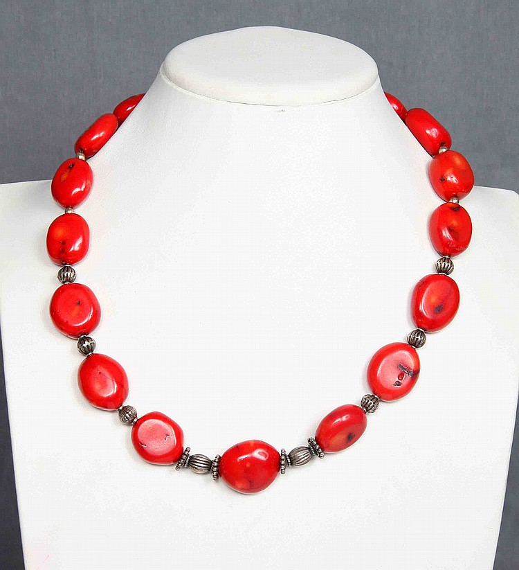 A STERLING SILVER AND CORAL NECKLACE