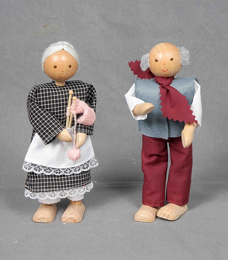 A PAIR OF WOOD DOLLS