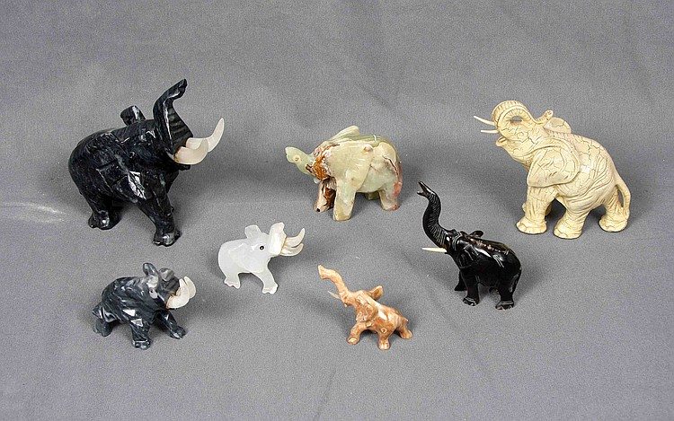 SEVEN CARVED ELEPHANTS FIGURES