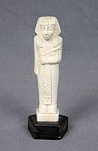 A EGYPTIAN CARVED IVORY FIGURE