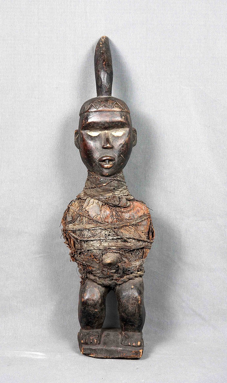 A BAKINO NKISI WOOD FIGURE