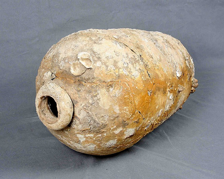 AN ANTIQUE ROMAN TERRACOTTA VESSEL
