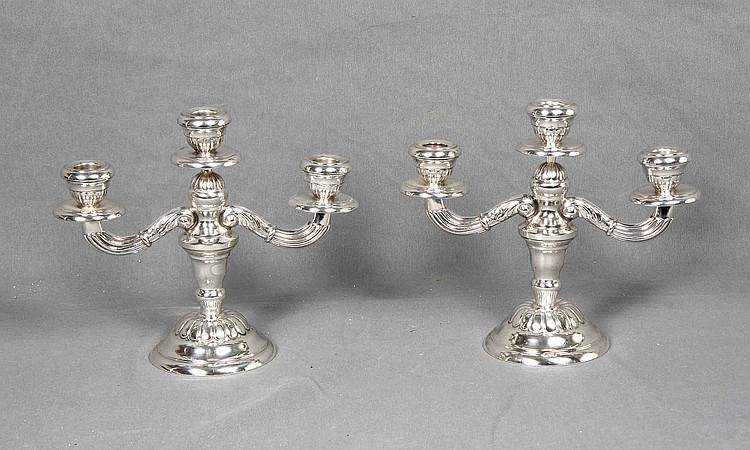 A PAIR OF SILVER THREE LIGHTS CANDLESTICKS