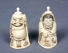 A PAIR OF CARVED AND POLYCHROME IVORY FIGURES