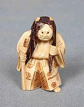 A CHINESE CARVED AND POLYCHROME IVORY NETSUKE, CIRCA 1940