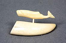 A CARVED IVORY FIGURE