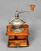 AN ANTIQUE WOOD COFFEE GRINDER