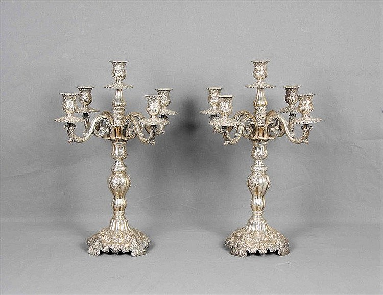 Pair of five-branched candelabra, in Spanish punched silver, with quadrangu