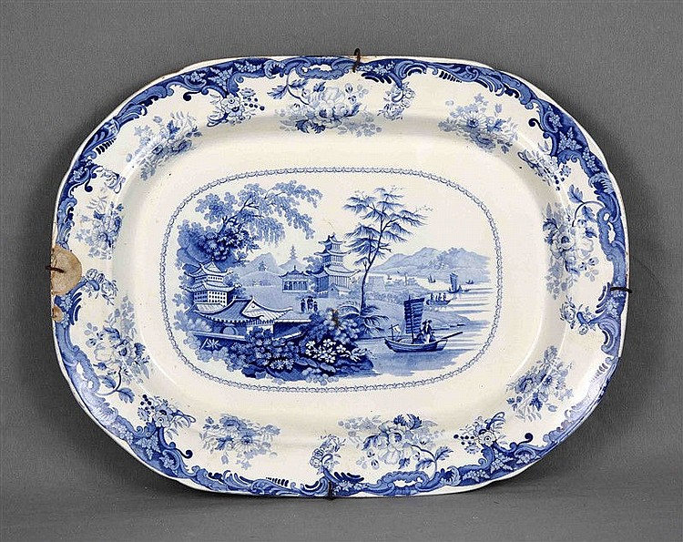 Chinese porcelain tray, polychrome and decorated with landscape and oriental motifs. Marks in the base. Size: 49x38 cm
